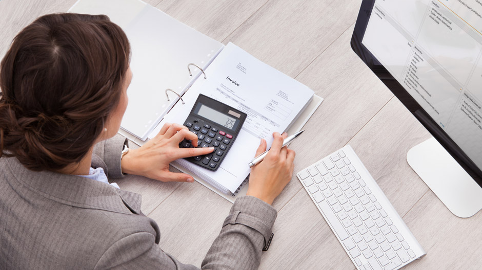 Businesswoman using Checkpoint tax and accounting software